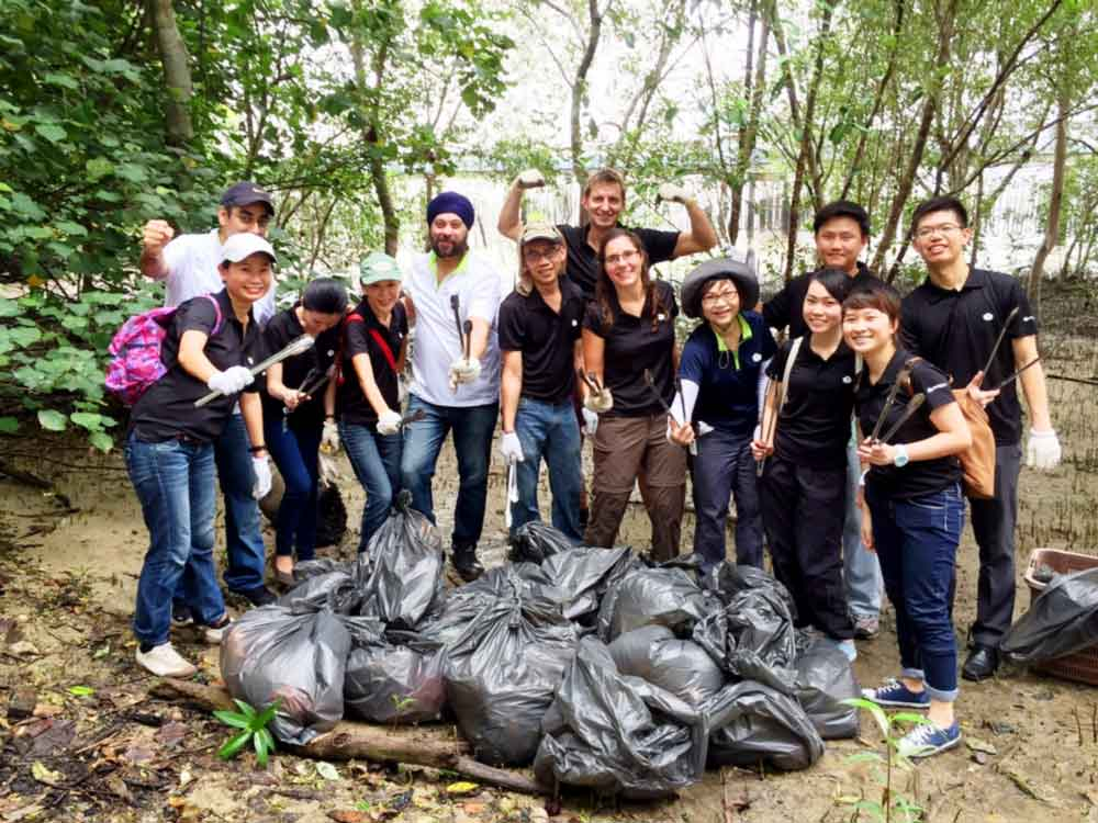 Berge Bulk volunteers with all the rubbish they cleared from the Mangrove.